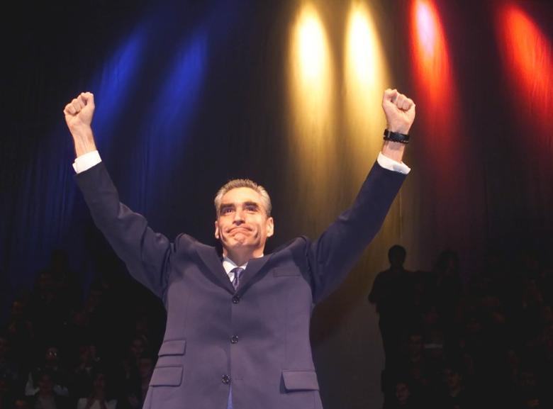 FILE PHOTO: Petre Roman waves to supporters during a pre-election rally in Bucharest on November 22, 2000. OP/FMS