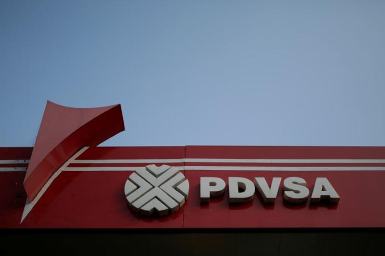 The corporate logo of the state oil company PDVSA is seen at a gas station in Caracas, Venezuela April 12, 2017. Picture taken April 12, 2017. REUTERS/Marco Bello/File Photo