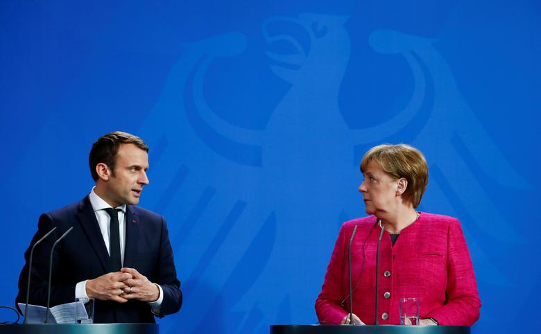 FILE PHOTO: German Chancellor Angela Merkel and French President Emmanuel Macron address a news conference at the Chancellery in Berlin, Germany, May 15, 2017.   REUTERS/Fabrizio Bensch/File Photo