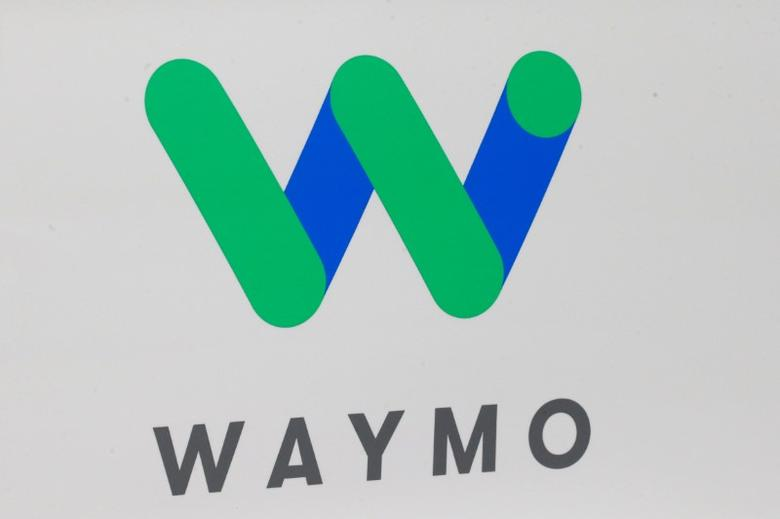 The Waymo logo is displayed during the company's unveil of a self-driving Chrysler Pacifica minivan during the North American International Auto Show in Detroit, Michigan, U.S., January 8, 2017.  REUTERS/Brendan McDermid