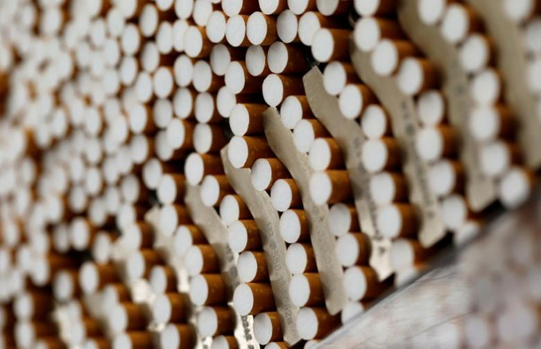 FILE PHOTO -  Cigarettes are seen during the manufacturing process in the British American Tobacco Cigarette Factory (BAT) in Bayreuth, southern Germany, April 30, 2014. REUTERS/Michaela Rehle/File Photo