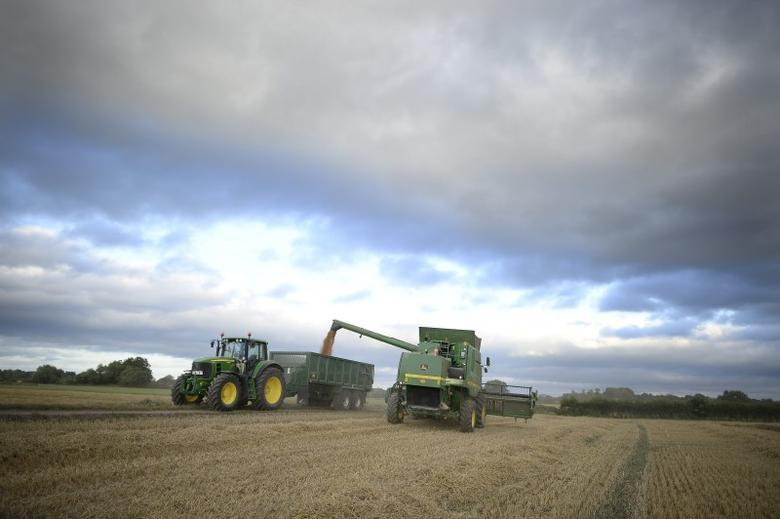 Farmer David Sowray drives a combine harvester through a field on the family's 600 acre farm in Humberton, northern England, August 2, 2013. REUTERS/Nigel Roddis