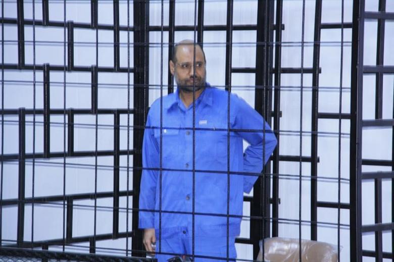 Saif al-Islam Gaddafi, son of late Libyan leader Muammar Gaddafi, attends a hearing behind bars in a courtroom in Zintan, June 22, 2014 . REUTERS/Stringer