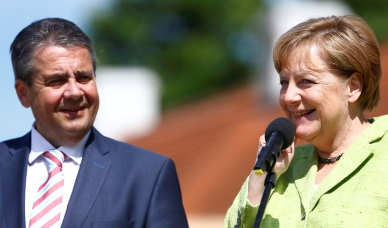 German Chancellor Angela Merkel and Vice Chancellor Sigmar Gabriel brief the media prior to a meeting with German government's Social Partners, leaders of labor unions and employer organizations, at the government guest house Meseberg Palace, Germany, June 14, 2017. REUTERS/Hannibal Hanschke