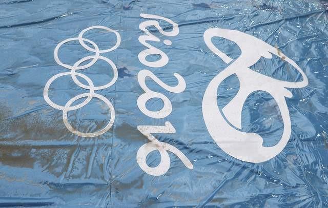 FILE PHOTO: 2016 Rio Olympics - Athletics - Maracana Stadium - Rio de Janeiro, Brazil - 11/08/2016. The Olympics logo is seen on a rain cover for the long jump sand pit. REUTERS/Kai Pfaffenbach