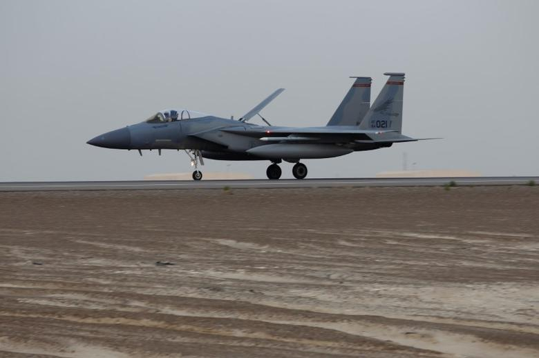 FILE PHOTO: A U.S. Air Force F-15 lands after completing a regional exercise at an Air Force Base in Arabian Gulf, March 13, 2017. REUTERS/Hamad I Mohammed