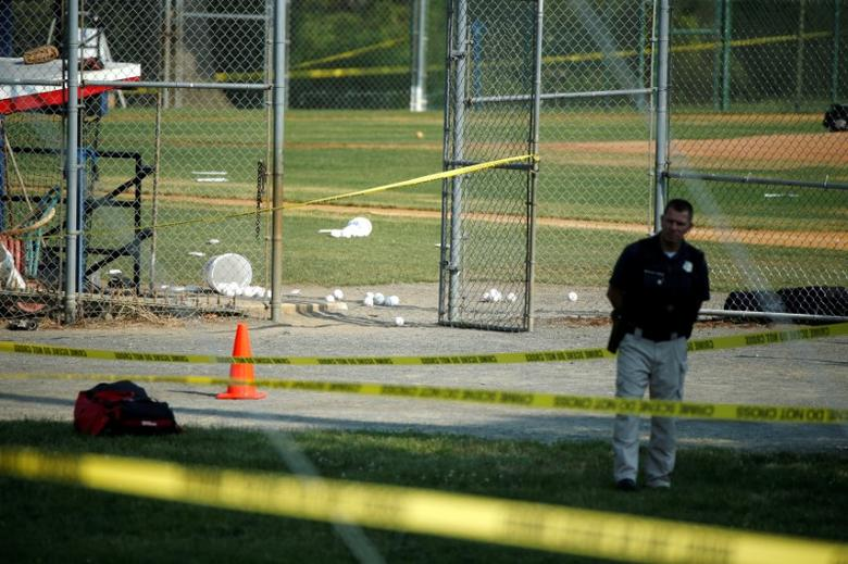 A police officer mans a shooting scene after a gunman opened fire on Republican members of Congress during a baseball practice near Washington in Alexandria, Virginia,  June 14, 2017. REUTERS/Joshua Roberts
