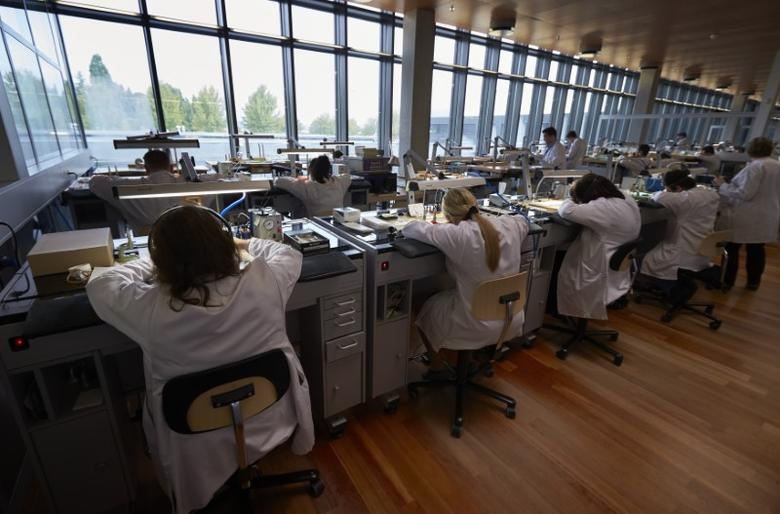 Vacheron Constantin watchmakers work on calibres in the company workshop in Plan-les-Ouates near Geneva October 14, 2014. Vacheron Constantin is part of the privately owned luxury group Richemont based in Geneva.   REUTERS/Denis Balibouse