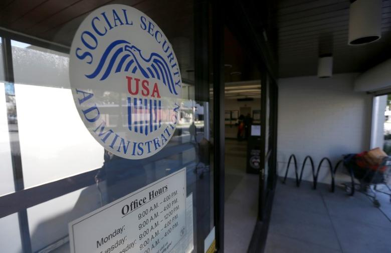 The entrance and logo of a Social Security Office in Pasadena, California U.S., March 14, 2017.   REUTERS/Mario Anzuoni - RTX31091