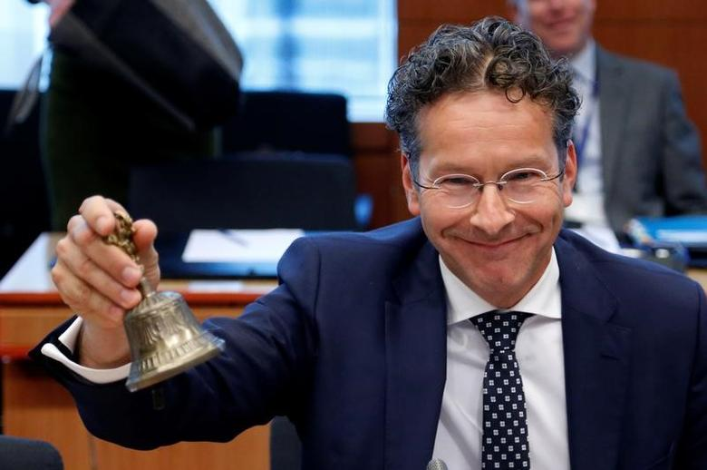 Dutch Finance Minister and Eurogroup President Jeroen Dijsselbloem rings the bell as he chairs a eurozone finance ministers meeting in Brussels, Belgium May 22, 2017. REUTERS/Francois Lenoir