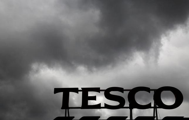 FILE PHOTO: Grey clouds hang over a Tesco Extra store in London, Britain June 4, 2014. REUTERS/Luke MacGregor/File Photo
