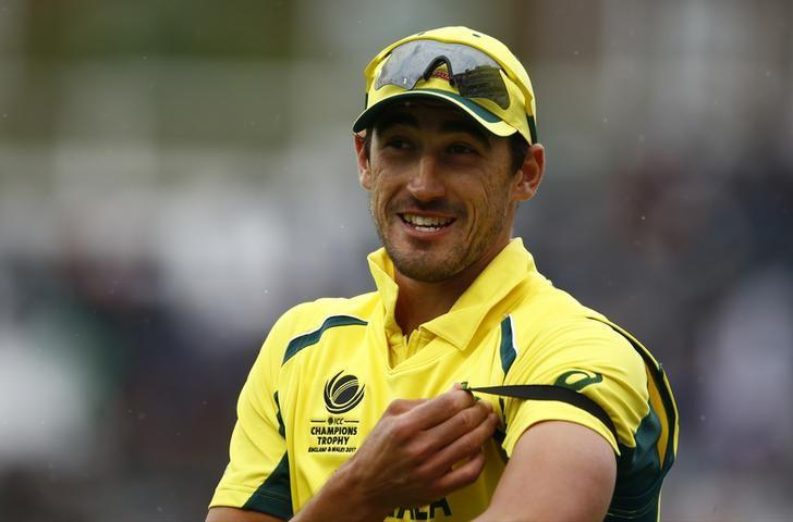 Britain Cricket - Australia v Bangladesh - 2017 ICC Champions Trophy Group A - The Oval - June 5, 2017 Australia's Mitchell Starc (L) at the end of the innings Action Images via Reuters / Peter Cziborra Livepic
