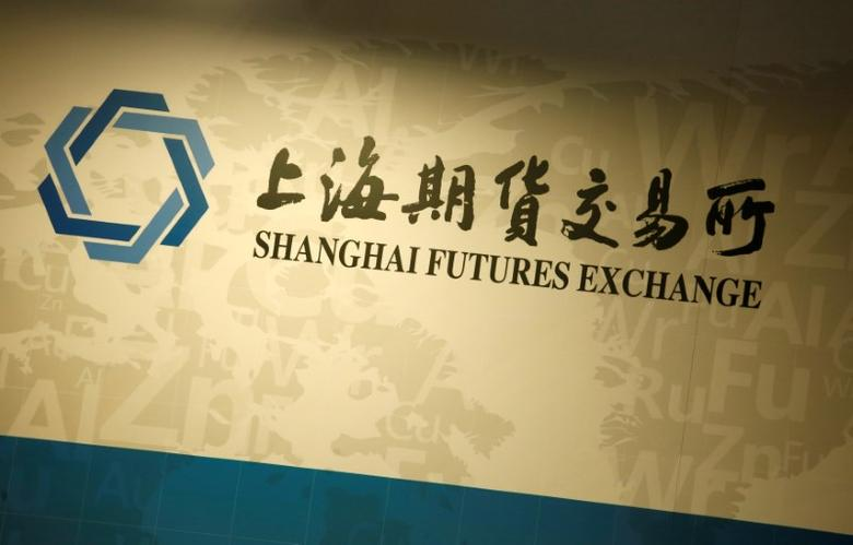 FILE PHOTO: A company logo of Shanghai Futures Exchange is displayed at a booth during LME Week Asia in Hong Kong, China June 14, 2016. REUTERS/Bobby Yip/File Photo