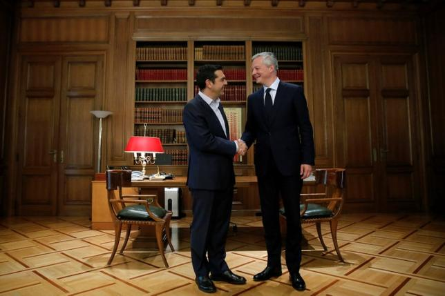 Greek Prime Minister Alexis Tsipras (L) welcomes French Finance Minister Bruno Le Maire at his office in Maximos Mansion in Athens, Greece, June 12, 2017. REUTERS/Costas Baltas