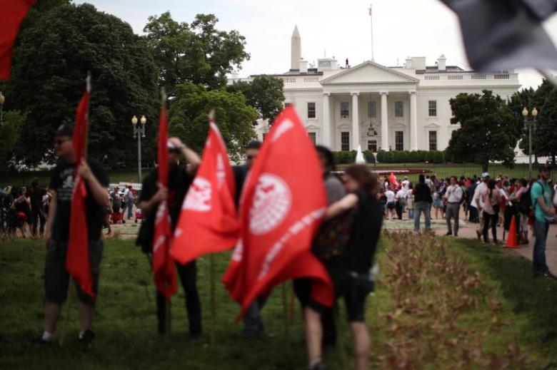 FILE PHOTO: People attend a demonstration on International Labor Day at Lafayette Park outside the White House in Washington D.C., U.S. May 1, 2017. REUTERS/Carlos Barria