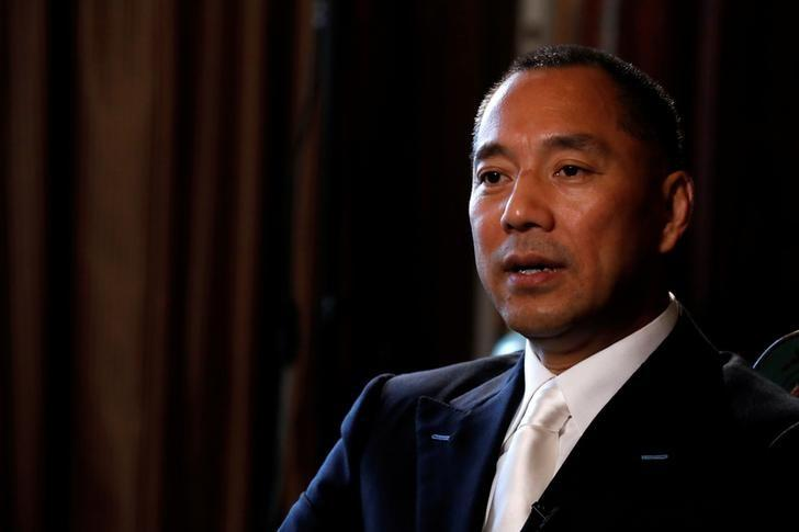 FILE PHOTO: Billionaire businessman Guo Wengui speaks during an interview in New York City, U.S., April 30, 2017.   REUTERS/Brendan McDermid/File Photo