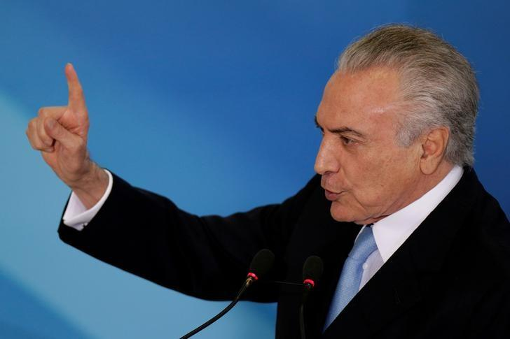 Brazil's President Michel Temer gestures during a inauguration ceremony of the new Minister of Justice, Torquato Jardim, at the Planalto Palace, in Brasilia, Brazil May 31, 2017. REUTERS/Ueslei Marcelino/Files