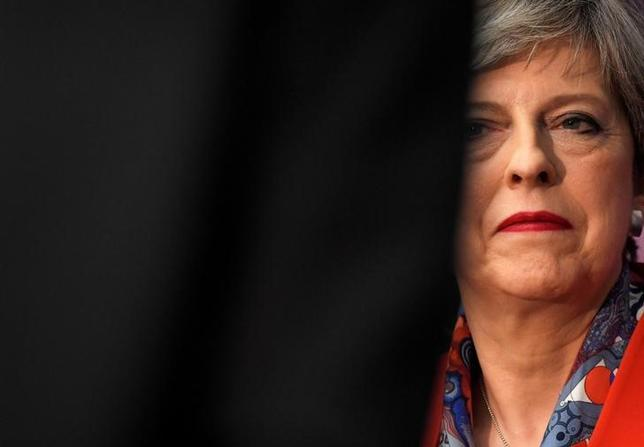 Britain's Prime Minister Theresa May waits to speak after retaining her seat at the count centre for the general election in Maidenhead, June 9, 2017. REUTERS/Toby Melville/Files