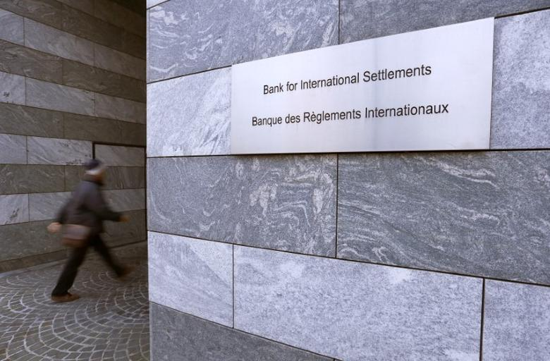 FILE PHOTO: A man enters the Bank for International Settlements (BIS) in Basel December 5, 2013. REUTERS/Arnd Wiegmann