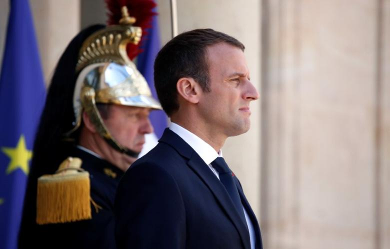 FILE PHOTO: French President Emmanuel Macron stands on the steps of the Elysee Palace in Paris, France, June 16, 2017. REUTERS/Christian Hartmann
