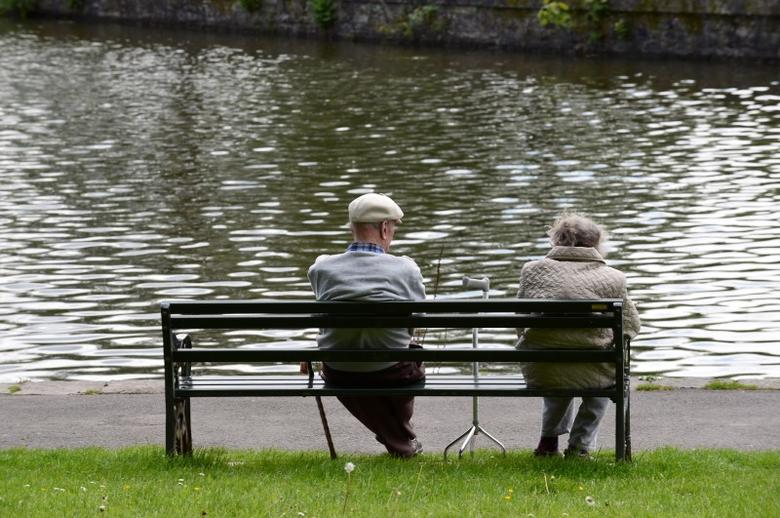 Pensioners sit on a bench in a park, Merthyr Tydfil, Wales, May 22, 2017. P REUTERS/Rebecca Naden
