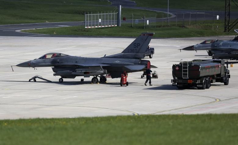 Two U.S. Air Force F-16 Fighting Falcon fighter jets stand on tarmac at the Spangdahlem Air base, Germany September 3, 2015.  REUTERS/Ina Fassbender