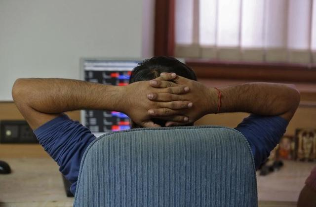 A broker reacts while trading at his computer terminal at a stock brokerage firm in Mumbai, India, February 26, 2016.REUTERS/Shailesh Andrade/Files
