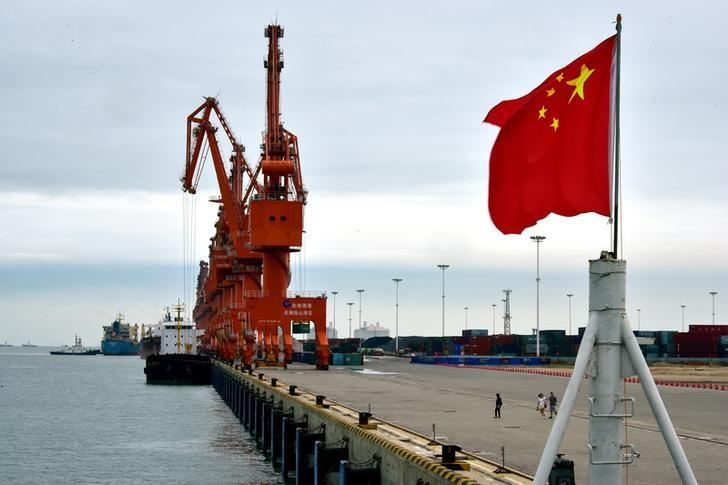 A Chinese national flag is seen at a port in Beihai, Guangxi province, China June 17, 2017. Picture taken June 17, 2017. REUTERS/Stringer ATTENTION EDITORS - THIS IMAGE WAS PROVIDED BY A THIRD PARTY. CHINA OUT. NO COMMERCIAL OR EDITORIAL SALES IN CHINA.