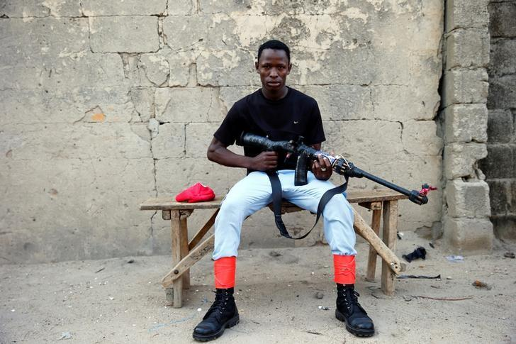 A member of the local militia group, otherwise known as CJTF, Baaka Ahmed, 25, poses for a portrait photograph in a compound in the city of Maiduguri, northern Nigeria June 5, 2017. Picture taken June 5, 2017. REUTERS/Akintunde Akinleye