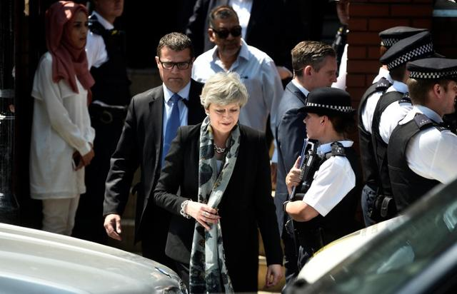 Britain's Prime Minister Theresa May leaves after visiting the Finsbury Park Mosque where a van was driven at Muslims outside the mosque in North London, Britain, June 19, 2017. REUTERS/Hannah McKay
