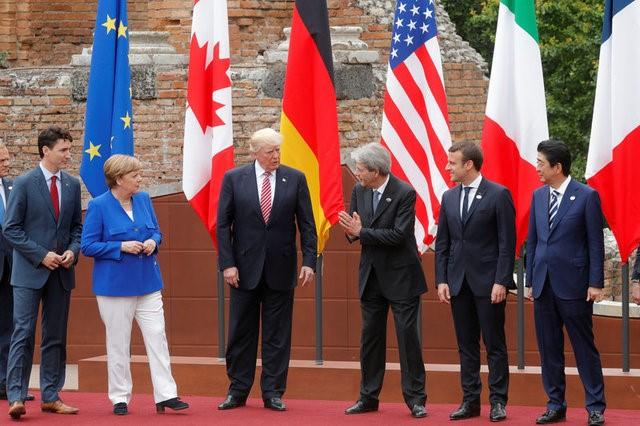 6月27日、米国のイメージがトランプ政権誕生後に全世界で急落し、大多数の人々がトランプ氏の国際問題に関する指導力を信頼していないとの調査結果をピュー・リサーチ・センターが発表した。写真はイタリアで開かれたG7サミットで5月26日撮影(2017年 ロイター/Philippe Wojazer)
