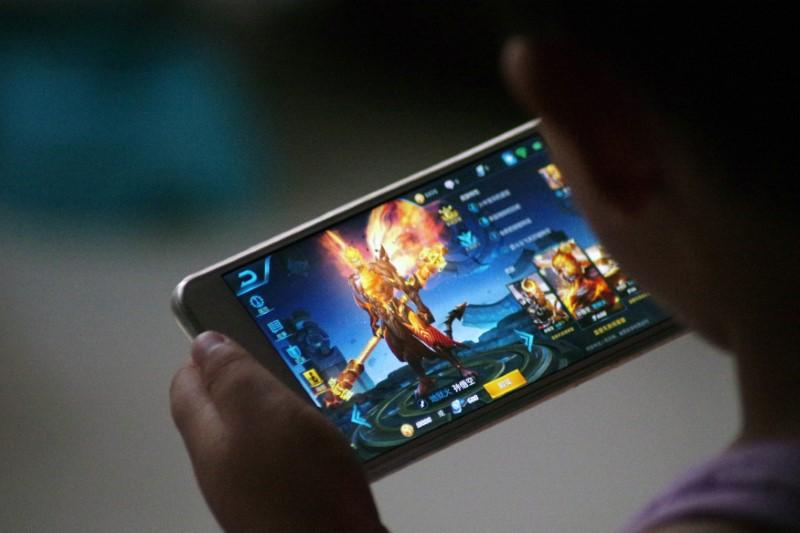 China's Tencent to limit play time of top-grossing game for