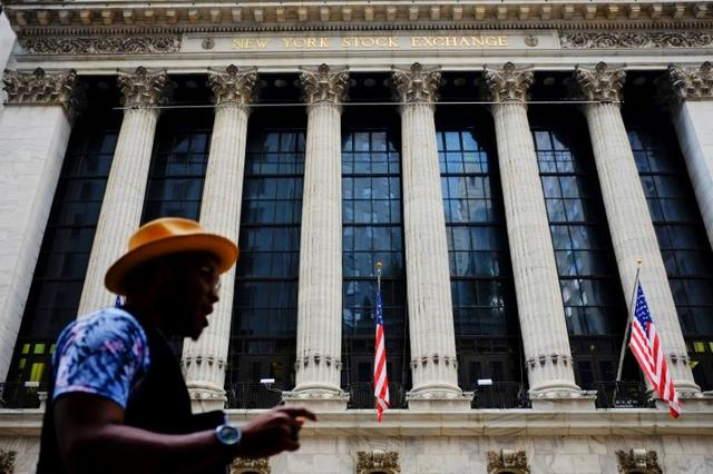 A man walks by New York Stock Exchange in the financial district in New York, U.S., August 10, 2017. REUTERS/Eduardo Munoz