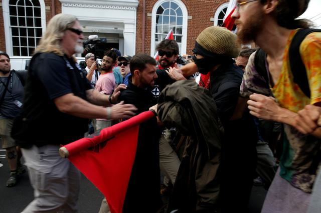 White supremacists clash with counter protesters during a rally in Charlottesville, Virginia, U.S., August 12, 2017.   REUTERS/Joshua Roberts