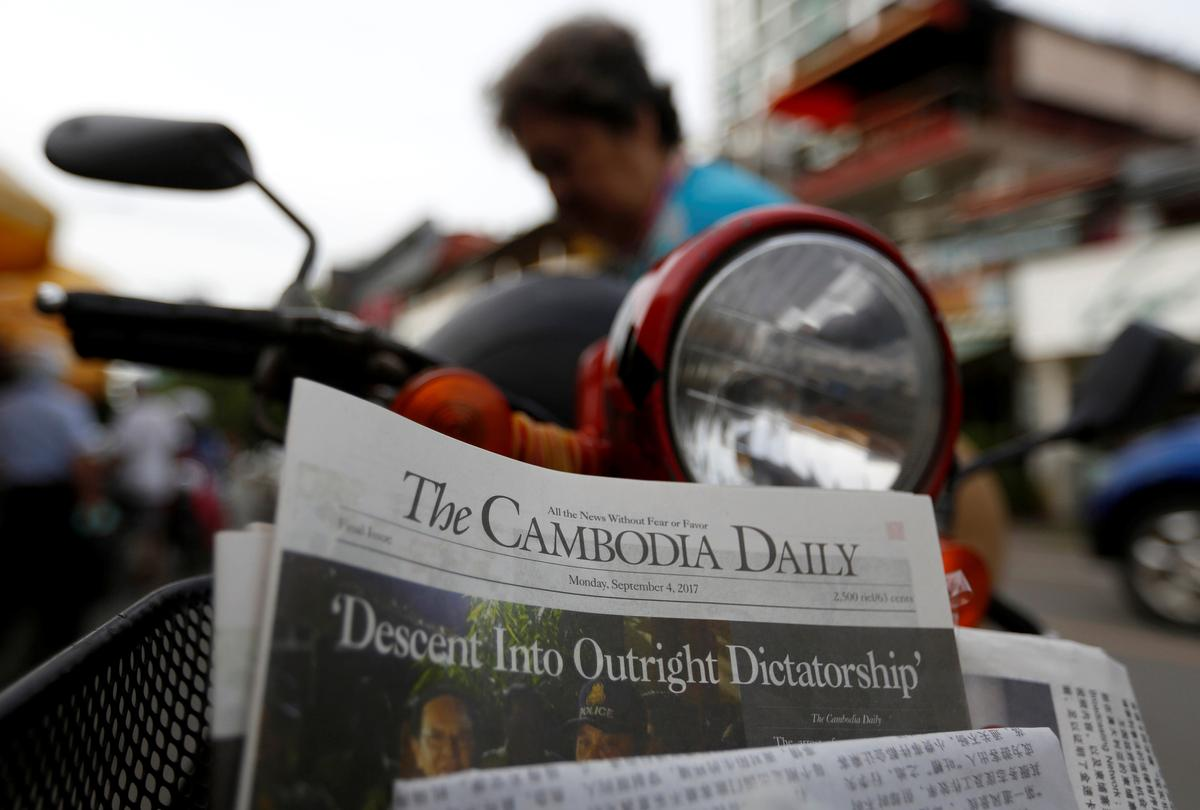 Cambodian paper shuts with 'dictatorship' parting shot - Reuters