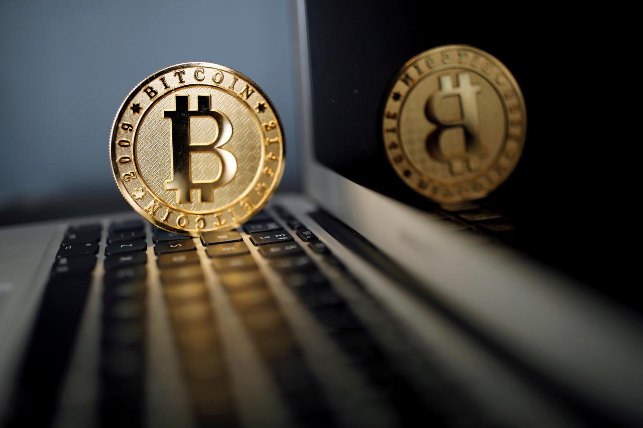 File Photo A Bitcoin Virtual Currency Coin Is Seen In An Ilration Picture Taken At La Maison Du Paris France June 23 2017