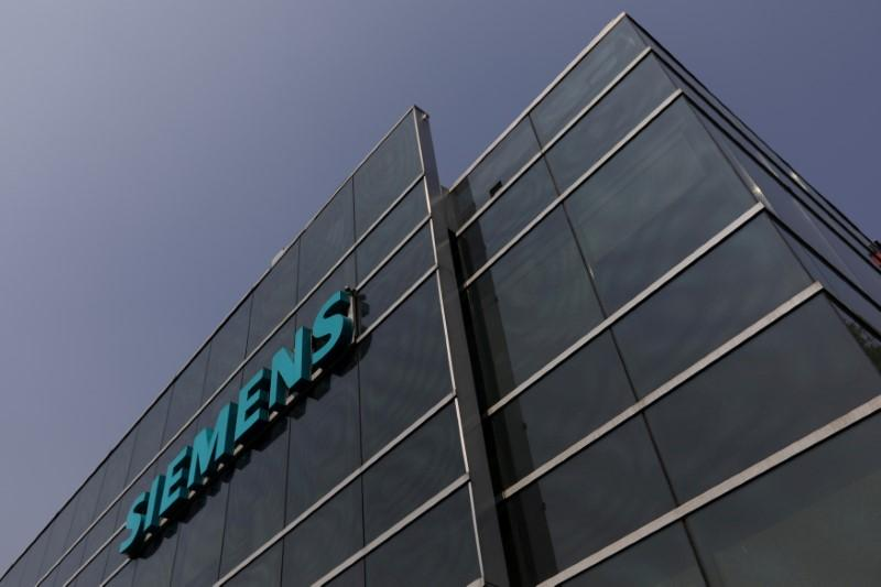 Siemens willing to sacrifice profit to soften job cut blow: source