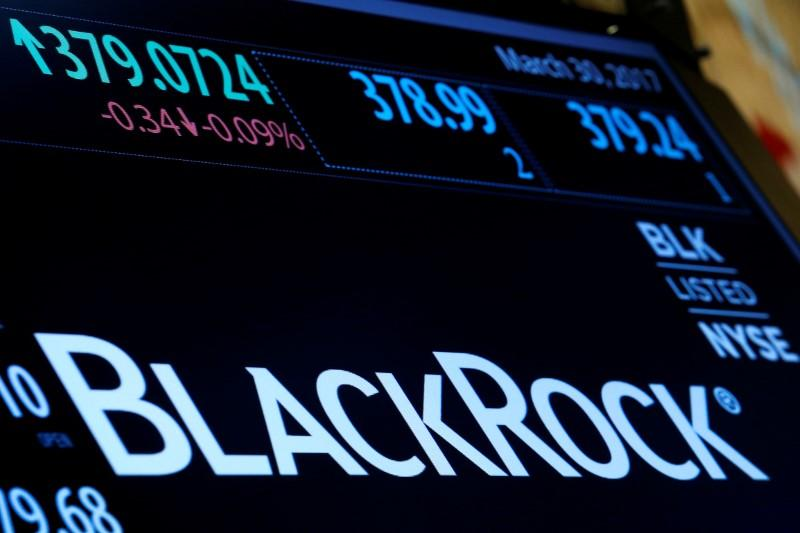 The company logo and trading information for BlackRock is displayed on a screen on the floor of the New York Stock Exchange (NYSE) in New York, U.S., March 30, 2017. Brendan McDermid