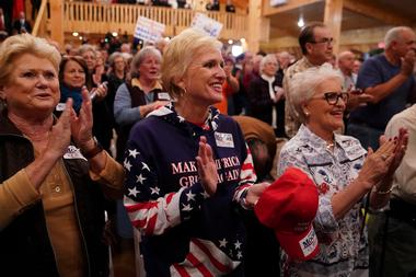 Supporters cheer at a Republican Senate candidate Roy Moore campaign rally...