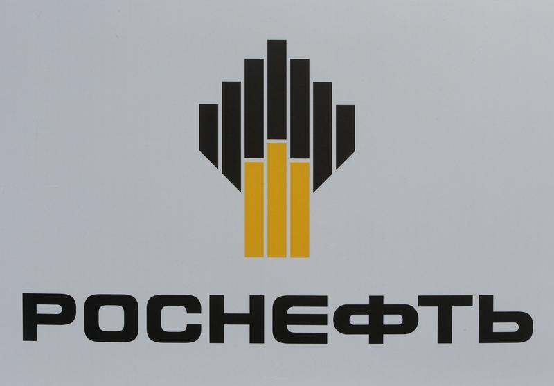 russia s rosneft bp agree to jointly tap arctic oil and gas file photo the logo of russia s oil producer rosneft is seen on a board at the st petersburg international economic forum 2017 spief 2017 in st