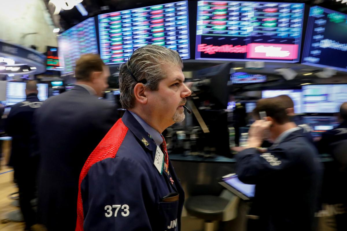 Wall Street edges higher as healthcare, bank...