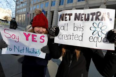 FILE PHOTO - Net neutrality advocates rally in front of the Federal...