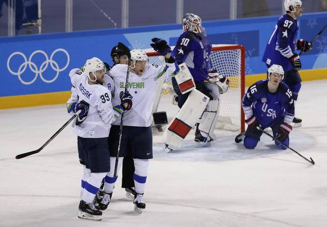 Ice Hockey – Pyeongchang 2018 Winter Olympics – Men Preliminary Round Match - U.S. v Slovenia - Kwandong Hockey Centre, Gangneung, South Korea – February 14, 2018 -  Jan Mursak (39) of Slovenia celebrates scoring on Team USA's Ryan Zapolski in overtime. REUTERS/David W Cerny