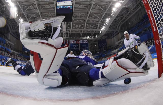 Ice Hockey – Pyeongchang 2018 Winter Olympics – Men Preliminary Round Match - U.S. v Slovenia - Kwandong Hockey Centre, Gangneung, South Korea – February 14, 2018 -  Jan Mursak of Slovenia scores on Team USA's Ryan Zapolski in overtime. REUTERS/Brian Snyder