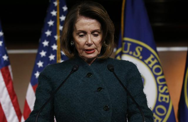 FILE PHOTO: U.S. House Minority Leader Nancy Pelosi holds her weekly news conference at the U.S. Capitol in Washington, U.S., January 18, 2018. REUTERS/Leah Millis