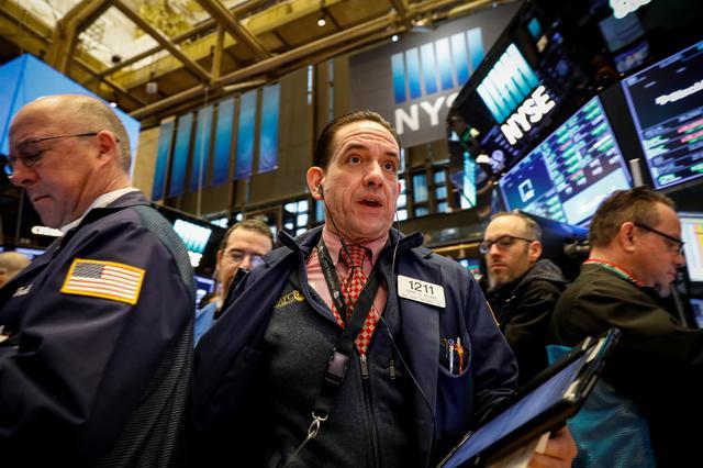 Traders work on the floor of the New York Stock Exchange, (NYSE) in New York, U.S., February 9, 2018. REUTERS/Brendan McDermid