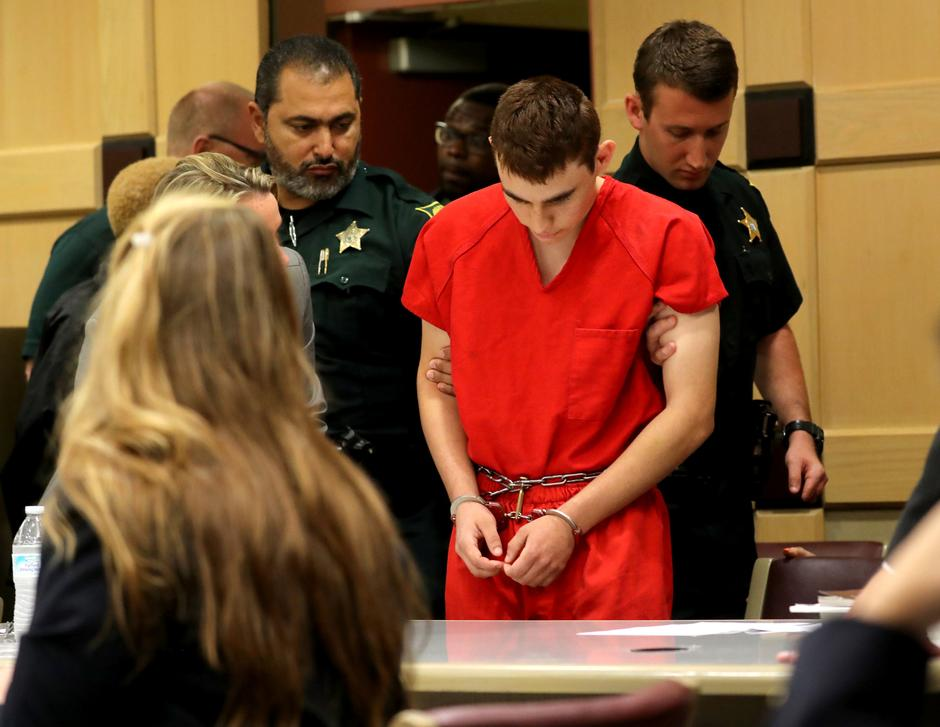 Image result for Head bowed, Florida shooting suspect returns to court for hearing