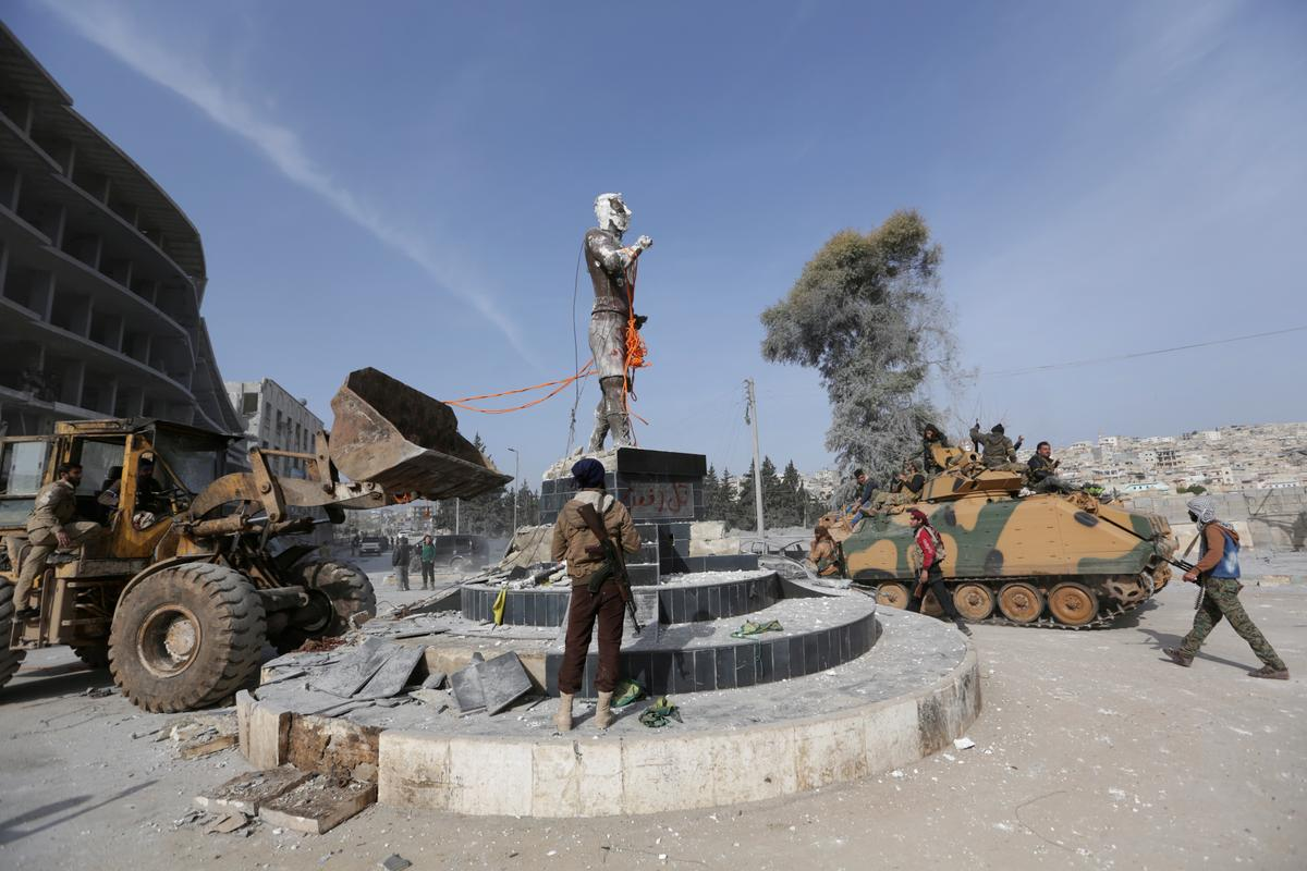 Turkey-backed forces pull down Kurdish statue in Afrin town center:...