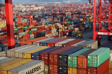 FILE PHOTO - Containers are seen at the Yangshan Deep Water Port, part of...