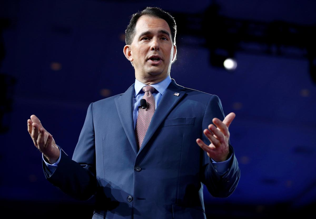 Wisconsin governor ordered to hold special elections after...